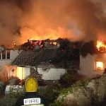 How can I protect my home's thatch roof from fire hazards?