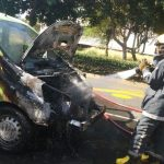 Road closed as vehicle catches fire