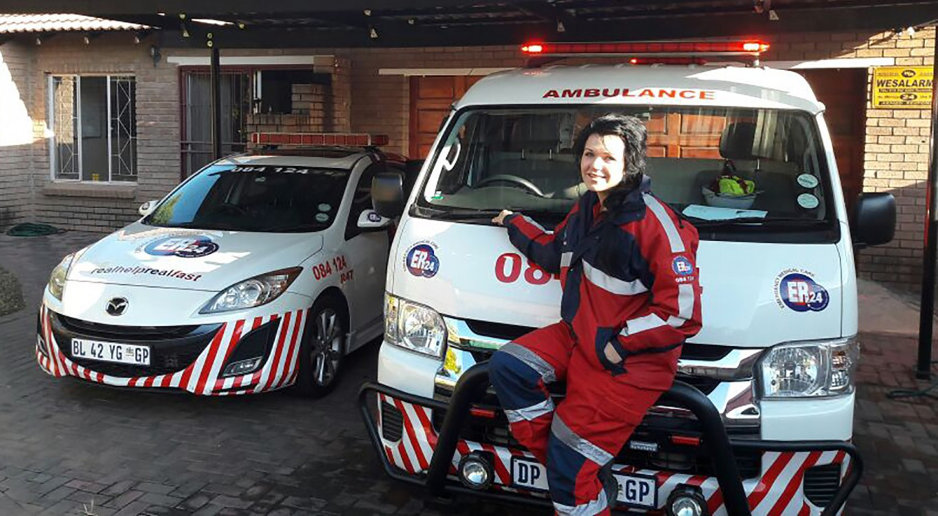 Charne Language, based at ER24 Rustenburg, with two of the vehicles you can expect to see on the road.