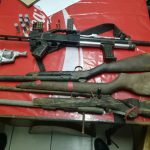 Suspect arrested with five firearms